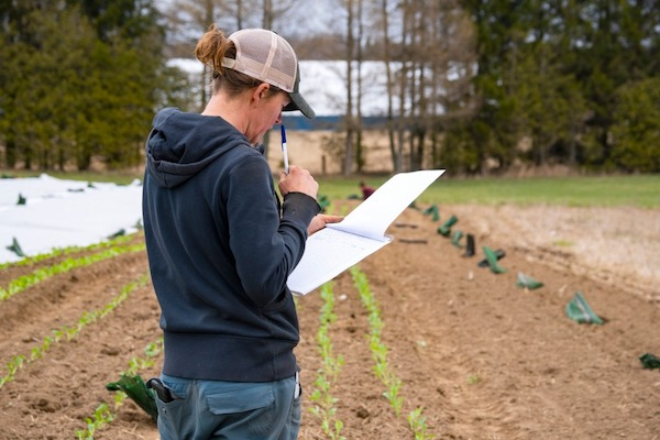 farmer with clipboard and paperwork