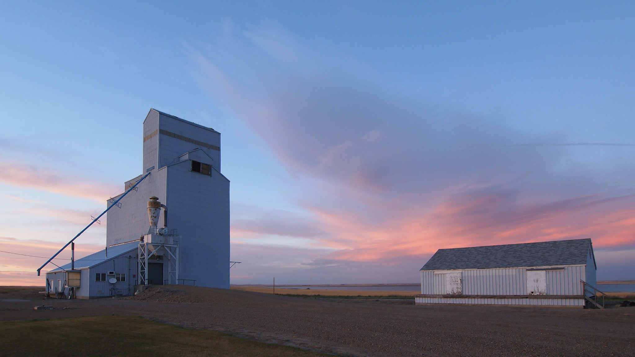 A grain elevator at sunset